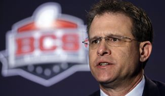 FILE - This Jan. 5, 2014 file photo shows Auburn head coach Gus Malzahn answering a question during a news conference for the NCAA BCS National Championship college football game in Newport Beach, Calif. On Sunday, March 2, 2014, Malzahn received the Bowden Award named after the ex-Seminoles coach, who coached them to the national title in 1993. (AP Photo/David J. Phillip, file)