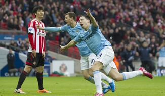 Manchester City's Samir Nasri, centre right, celebrates after scoring as Sunderland's Ki Sung-Yueng, left, looks on during the League Cup Final at Wembley Stadium, London, England, Sunday March 2, 2014. (AP Photo/Jon Super)