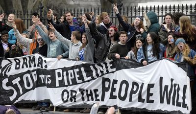 People protest against the XL Pipeline outside the White House in Washington, Sunday, March 2, 2014. (AP Photo/Susan Walsh)