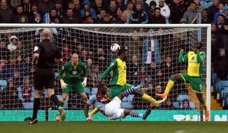Aston Villa's Christian Benteke scores, centre, scores his side's first goal, during the English Premier League match against Norwich City,  at Villa Park, Birmingham, England, Sunday March 2, 2014. (AP Photo /PA, Peter Byrne) UNITED KINGDOM OUT