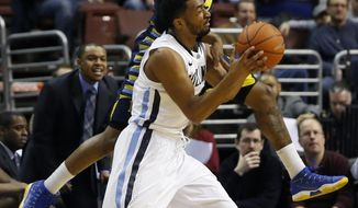 Villanova's Darrun Hilliard II, bottom, is fouled by Marquette's Todd Mayo during the first half of an NCAA college basketball game on Sunday, March 2, 2014, in Philadelphia. (AP Photo/Matt Slocum)