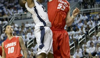 New Mexico's Alex Kirk blocks the shot of Nevada's Deonte Burton during the second half of an NCAA college basketball game Sunday, March 2, 2014, in Reno, Nev. (AP Photo/Reno Gazette-Journal, Tom R. Smedes) CARSON CITY OUT NO SALES