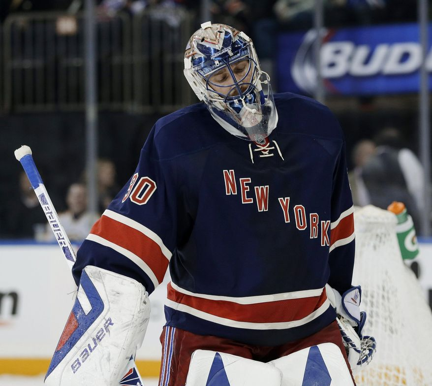 New York Rangers goalie Henrik Lundqvist reacts after being scored on by Boston Bruins' Milan Lucic during the third period of the NHL hockey game Sunday, March 2, 2014, in New York. The Bruins beat the Rangers 6-3. (AP Photo/Seth Wenig)