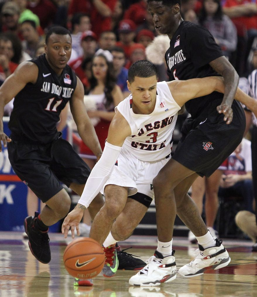 Fresno State's Cezar Guerrero drives past San Diego State's Dwayne Polee II during the first half of an NCAA college basketball game in Fresno, Calif., Saturday, March 1, 2014. (AP Photo/Gary Kazanjian)