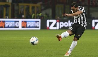 Juventus forward Carlos Tevez, of Argentina, scores during a Serie A soccer match between AC Milan and Juventus, at the San Siro stadium in Milan, Italy, Sunday, March 2, 2014. (AP Photo/Luca Bruno)