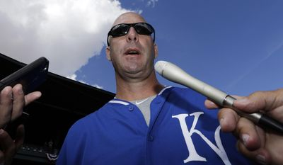 Former Chicago Cubs manager and current Kansas City Royals third base coach Dale Sveum talks to reporters before a spring exhibition baseball game on Sunday, March 2, 2014, in Mesa, Ariz. (AP Photo/Morry Gash)