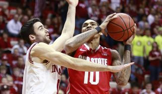 Indiana forward Will Sheehey, left, fouls Ohio State forward LaQuinton Ross as Ross goes to the basket in the first half of an NCAA basketball game in Bloomington, Ind. Sunday, March 2, 2014. (AP Photo/R Brent Smith)
