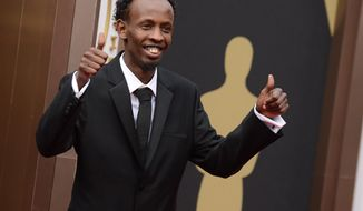 Barkhad Abdi arrives at the Oscars on Sunday, March 2, 2014, at the Dolby Theatre in Los Angeles.  (Photo by Jordan Strauss/Invision/AP)