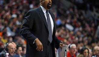 New York Knicks coach Mike Woodson yells to his team during the second half of an NBA basketball game against the Chicago Bulls on Sunday, March 2, 2014, in Chicago. The Bulls won 109-90. (AP Photo/Jeff Haynes)