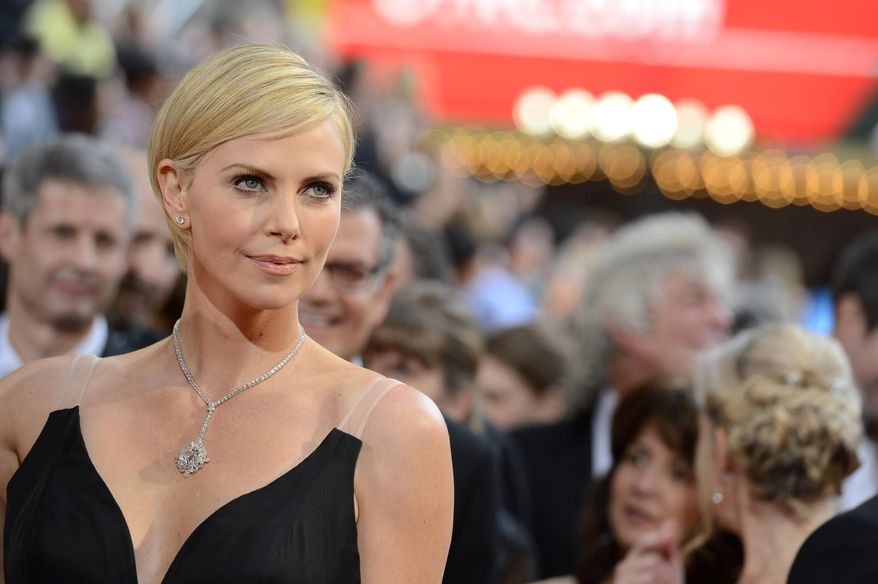 Charlize Theron arrives at the Oscars on Sunday, March 2, 2014, at the Dolby Theatre in Los Angeles.  (Photo by Dan Steinberg/Invision/AP)