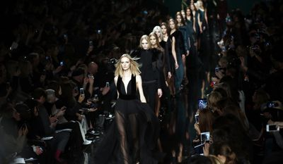 Models wear creations for Elie Saab's  ready-to-wear fall/winter 2014-2015 fashion collection presented in Paris, Monday, March 3, 2014. (AP Photo/Jerome Delay)