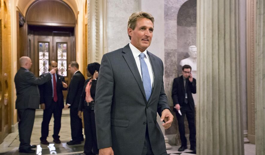 Sen. Jeff Flake, Arizona Republican, leaves the Senate Chamber on Sept. 30, 2013. (Associated Press) ** FILE **