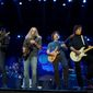 Doobie Brothers band members Patrick Simmons, Marc Russo, Tom Johnston and John McFee play at a concert in Milwaukee.  A currently untitled tribute album, set for release later this year, will feature the Doobies Brothers working with many of country music's hottest stars such as Brad Paisley (below). (associated press photographs)