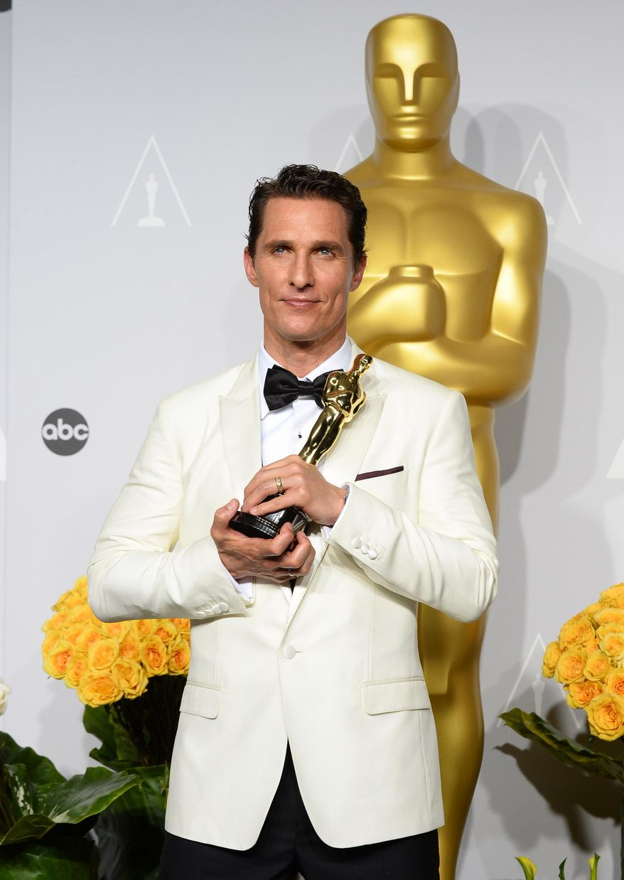 """Matthew McConaughey holds the award for best actor for his role in the """"Dallas Buyers Club"""" in the press room during the Oscars at the Dolby Theatre on Sunday, March 2, 2014, in Los Angeles.  (Photo by Jordan Strauss/Invision/AP)"""