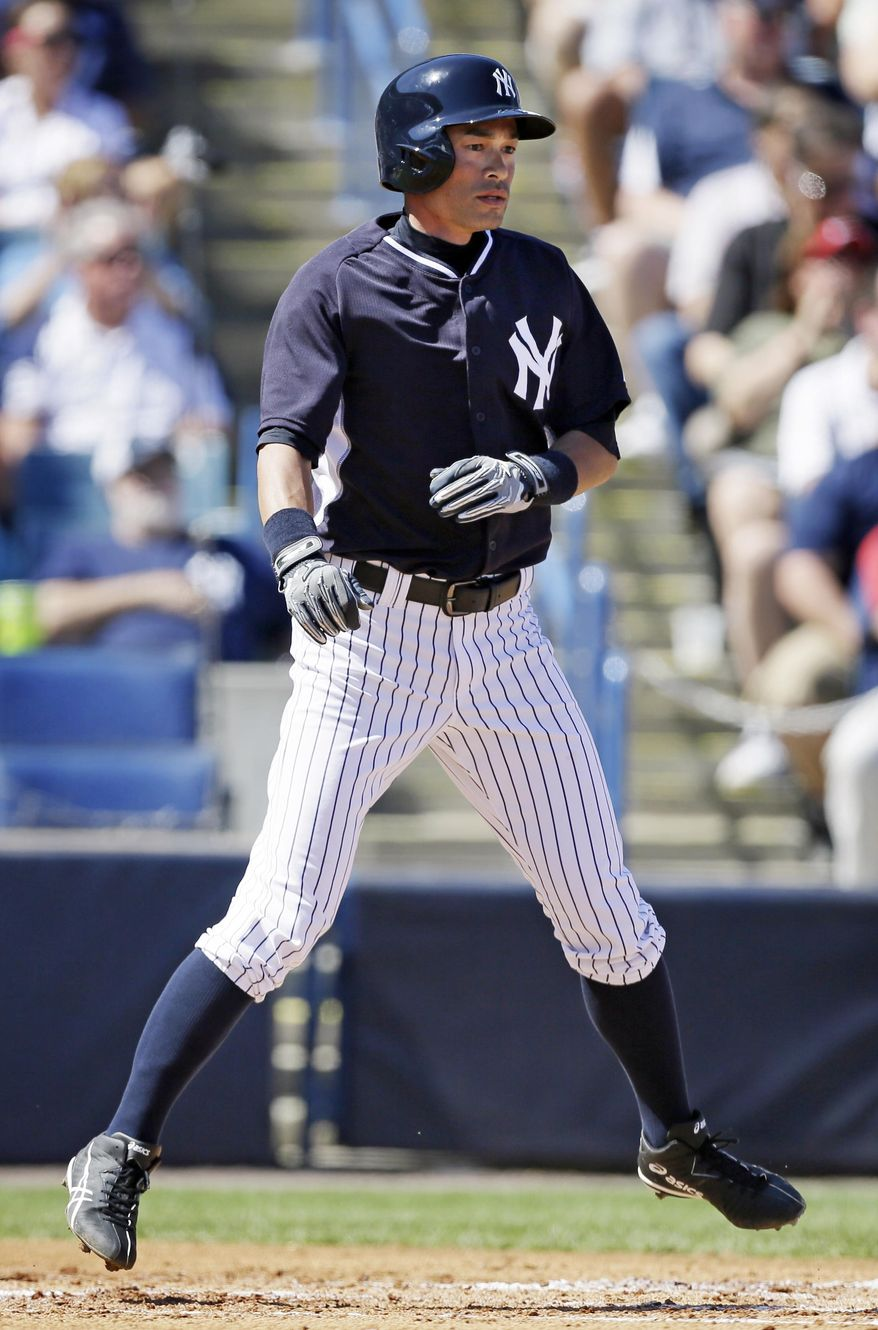 New York Yankees right fielder Ichiro Suzuki reacts after scoring a run in the second inning of an exhibition baseball game against the Washington Nationals, Monday, March 3, 2014, in Tampa, Fla. (AP Photo/Charlie Neibergall)