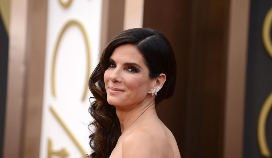 Sandra Bullock arrives at the Oscars on Sunday, March 2, 2014, at the Dolby Theatre in Los Angeles.  (Photo by Jordan Strauss/Invision/AP) ** FILE **
