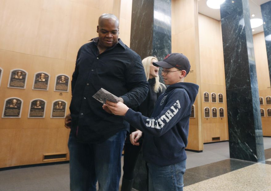 Former Chicago White Sox player Frank Thomas signs an autograph for Joseph Grande of Wheatfield, N.Y., during his orientation visit at the Baseball Hall of Fame on Monday, March 3, 2014, in Cooperstown, N.Y. Thomas will be inducted to the hall in July. (AP Photo/Mike Groll)