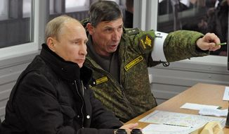 Russian President Vladimir Putin, listens to Gen. Ivan Buvaltsev, right, as they observe a military exercise near St. Petersburg, Russia, Monday, March 3, 2014.  pro-Russian troops held all Ukrainian border posts Monday in Crimea, as well as all military facilities and a key ferry terminal, cementing their stranglehold on the strategic Ukrainian peninsula. (AP Photo/RIA-Novosti, Mikhail Klimentyev, Presidential Press Service)