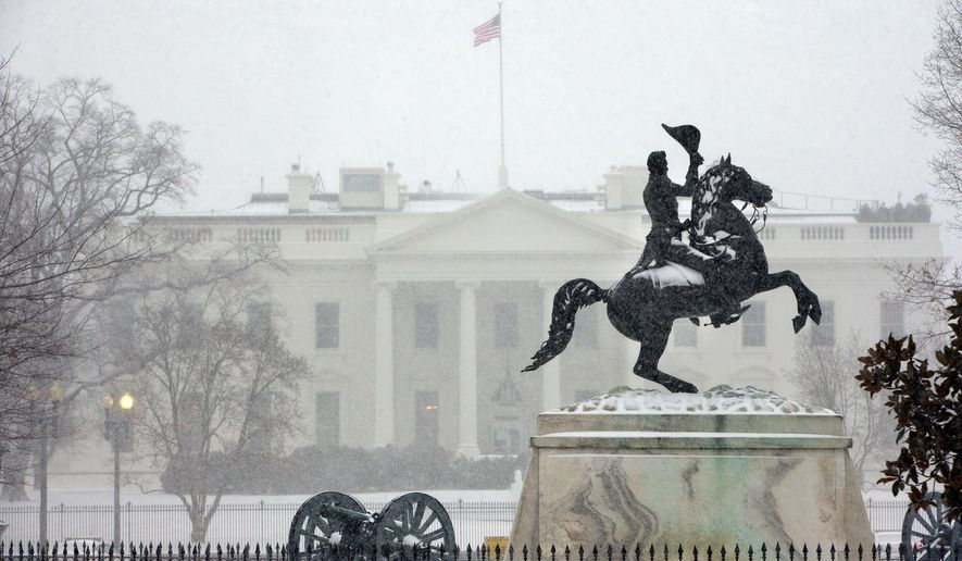 The statue of President Andrew Jackson at the Battle of New Orleans, sculpted in 1853 by Clark Mill sits in the falling snow in Lafayette Park across the street from the White House in Washington, Monday, March 3, 2014. The winter weather prompted area schools and the federal government to close and the National Weather Service has issued a Winter Storm Warning for the greater Washington Metropolitan region. (AP Photo/Pablo Martinez Monsivais)