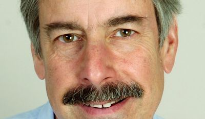 This June 30, 2008 photo shows Thomas Baden Jr., editor of The News-Times in Danbury, Conn., who has been named editor of The Daily Record in Baltimore. Baden led The News-Times' coverage of the Sandy Hook Elementary School shooting in Newtown, Conn., in 2012. Daily Record Publisher Suzanne E. Fischer-Huettner announced Baden's selection on Monday. (AP Photo/The Connecticut Post, Ned Gerard)