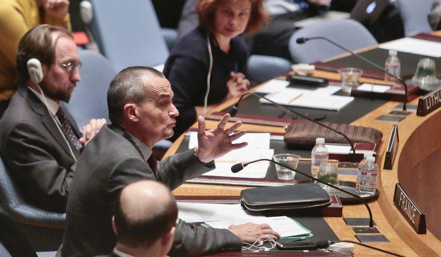 U.N. French Ambassador Gerard Araud, second from left, speaks during a U.N. Security Council meeting on Ukraine, Monday March 3, 2014, at U.N. headquarters.  (AP Photo/Bebeto Matthews) ** FILE **