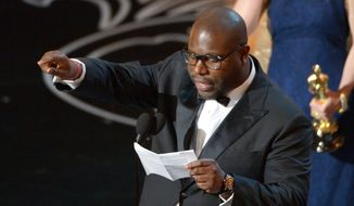 "Steve McQueen accepts the award for the best picture of the year for ""12 Years a Slave"" during the Oscars at the Dolby Theatre on Sunday, March 2, 2014, in Los Angeles.  (Photo by John Shearer/Invision/AP)"