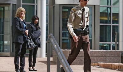 Texas Deputy James Boyd walks from court during a break in a sentencing hearing for a woman who pleaded guilty to buying the handgun used to kill Nathan Leon and the director of Colorado Prisons, at the Federal Courthouse, in Denver, Monday March 3, 2014. Stevie Marie Anne Vigil was sentenced to more than two years in prison and three years supervision for buying the handgun for Evan Ebel, a parolee and member of a white supremacist prison gang. Boyd, who was shot by Ebel, spoke during the hearing. (AP Photo/Brennan Linsley)