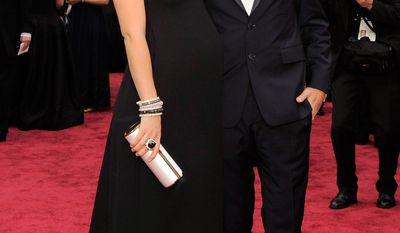 Olivia Wilde, left, and Jason Sudeikis arrive at the Oscars on Sunday, March 2, 2014, at the Dolby Theatre in Los Angeles.  (Photo by Chris Pizzello/Invision/AP)