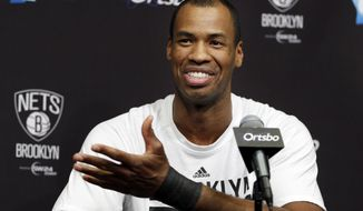 Brooklyn Nets Jason Collins speaks during a news conference before an NBA basketball game against the Chicago Bulls at the Barclays Center, Monday, March 3, 2014, in New York. More than a week after becoming the league's first openly gay player, Collins will finally get to play a home game. (AP Photo/Seth Wenig)