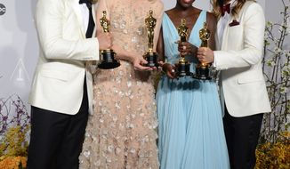 """Matthew McConaughey, from left, holds his award for best actor for his role in """"Dallas Buyers Club"""", Cate Blanchett holds her award for best actress in """"Blue Jasmine"""", Lupita Nyong'o holds her award for best supporting actress for """"12 Years a Slave,"""" and Jared Leto holds hi award for best supporting actor in """"Dallas Buyers Club"""" in the press room during the Oscars at the Dolby Theatre on Sunday, March 2, 2014, in Los Angeles.  (Photo by Jordan Strauss/Invision/AP)"""