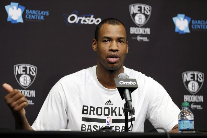 Brooklyn Nets Jason Collins speaks during a news conference before an NBA basketball game against the Chicago Bulls at the Barclays Center, Monday, March 3, 2014, in New York. More than a week after becoming the league's first openly gay player, Collins will finally get to play a home game. (AP Photo/Seth Wenig) **FILE**