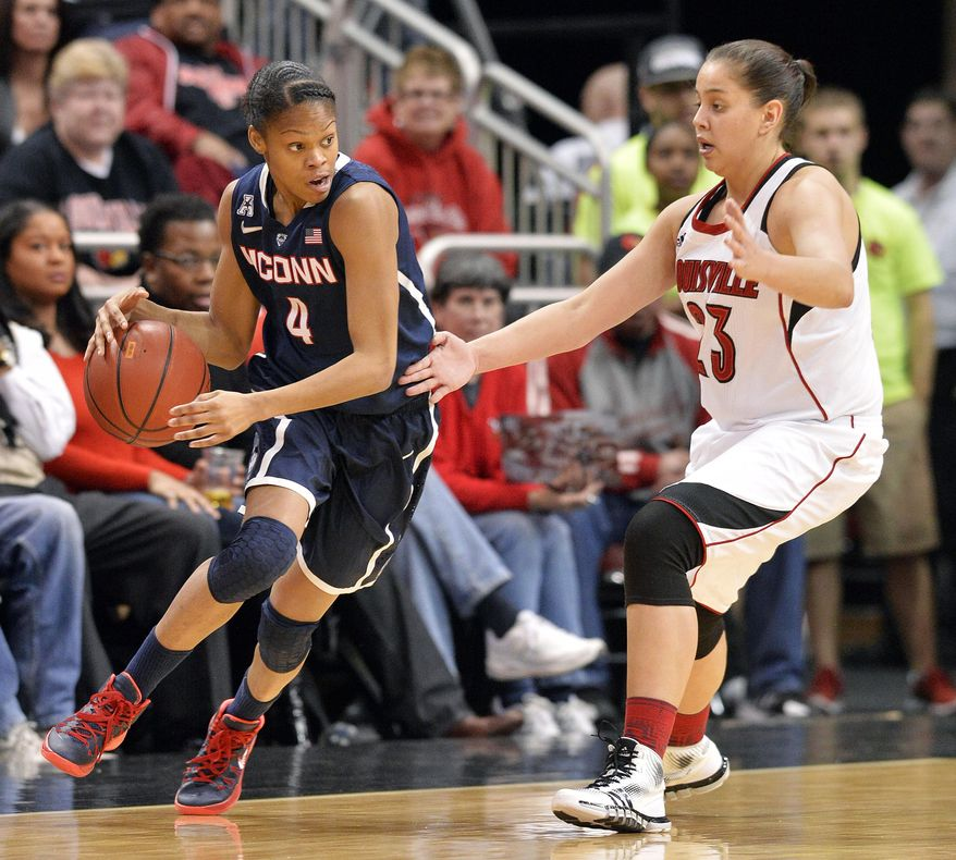 Connecticut Moriah Jefferson, left, attempts to drive around the defense of Louisville's Shoni Schimmel during the first half of an NCAA college basketball game, Monday, March 3, 2014, in Louisville, Ky. (AP Photo/Timothy D. Easley)