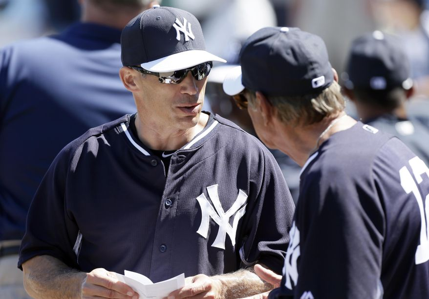 New York Yankees manager Joe Girardi, left, talks with former New York Jets quarterback Joe Namath before an exhibition baseball game between the Yankees and the Washington Nationals, Monday, March 3, 2014, in Tampa, Fla. (AP Photo/Charlie Neibergall)
