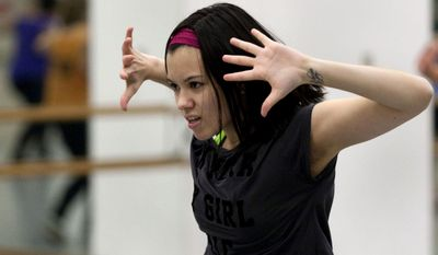 In this Jan. 22, 2014 photo, Millikin University freshman Shay Davis, of Paxton, Ill., dances to a routine created by instructor Demetruis Spidle for Beyonce's 'Grown Woman' during a hip-hop class at the Decatur Indoor Sports Center in Decatur, Ill. (AP Photo/Herald & Review, Danny Damiani)