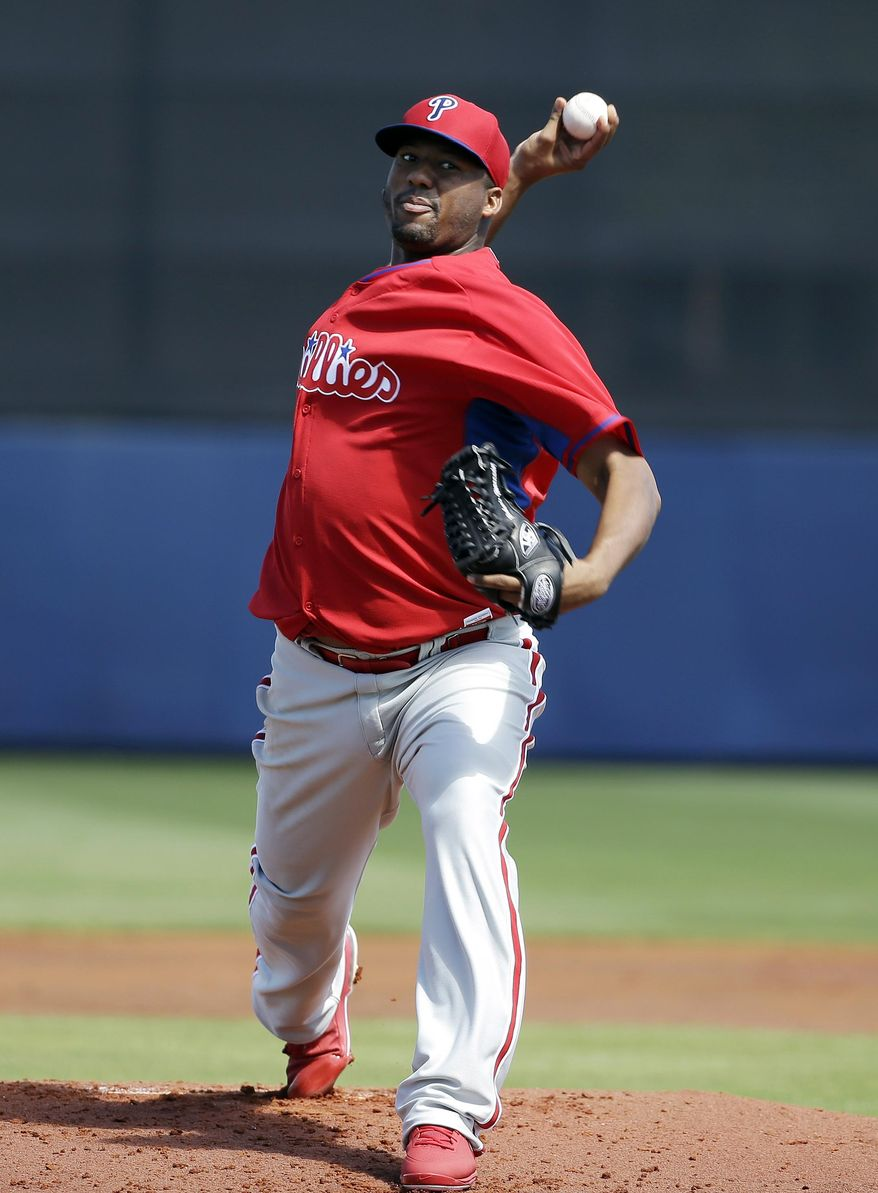 Philadelphia Phillies pitcher Roberto Hernandez delivers a warm-up throw in the first inning an exhibition baseball game against the Tampa Bay Rays, Monday, March 3, 2014, in Port Charlotte, Fla. (AP Photo/Steven Senne)