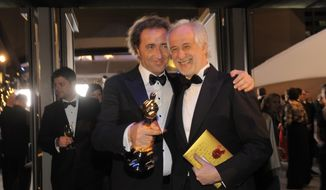 """Paolo Sorrentino, left, poses with the award for best foreign language film of the year for """"The Great Beauty"""" with Toni Servillo at the Governors Ball after the Oscars on Sunday, March 2, 2014, at the Dolby Theatre in Los Angeles.  (Photo by Chris Pizzello/Invision/AP)"""