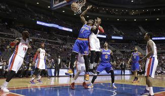 New York Knicks forward Amar'e Stoudemire (1), defended by Detroit Pistons center Andre Drummond, makes a basket during the first half of an NBA basketball game in Auburn Hills, Mich., Monday, March 3, 2014. (AP Photo/Carlos Osorio)