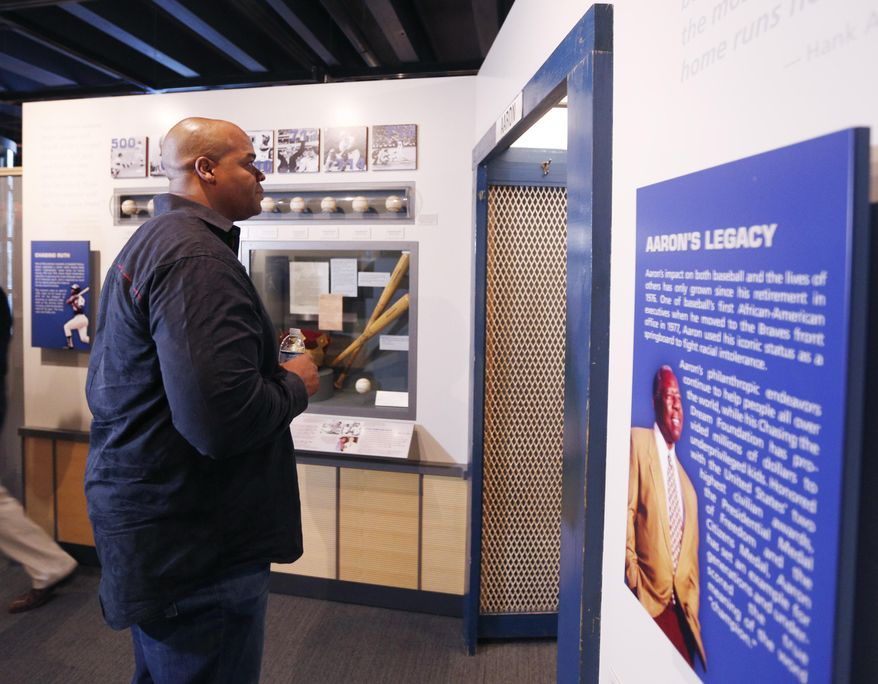 Former Chicago White Sox player Frank Thomas visits a Hank Aaron exhibit during his orientation visit at the Baseball Hall of Fame on Monday, March 3, 2014, in Cooperstown, N.Y. Thomas will be inducted to the hall in July. (AP Photo/Mike Groll)