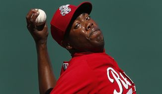 Cincinnati Reds pitcher Aroldis Chapman throws against the Seattle Mariners during an exhibition baseball game in Goodyear, Ariz., Monday, March 3, 2014. (AP Photo/Paul Sancya)