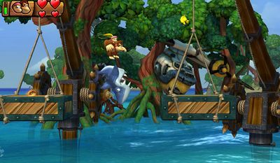 Donkey and Dixie Kong play with sharks in the video game Donkey Kong Country: Tropical Freeze for the Nintendo Wii U.