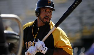 Pittsburgh Pirates' Pedro Alvarez  waits his turn to hit during batting practice before  an exhibition spring training baseball game  against the Boston Red Sox in Bradenton, Fla., Monday, March 3, 2014. (AP Photo/Gene J. Puskar)