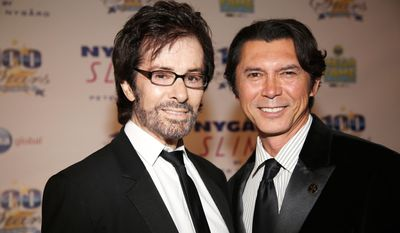 George Chakiris, left, and Lou Diamond Phillips arrive at the 24th Night of 100 Stars Oscars Viewing Gala at The Beverly Hills Hotel on Sunday, March 2, 2014 in Beverly Hills, Calif. (Photo by Annie I. Bang /Invision/AP)