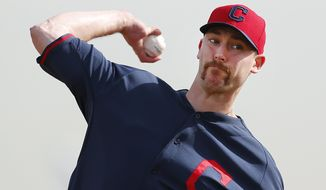 Cleveland Indians pitcher John Axford throws during spring training baseball practice in Goodyear, Ariz., Friday, Feb. 21, 2014. (AP Photo/Paul Sancya)
