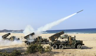 South Korean Army's 130mm multiple rocket launchers fire live rounds during an exercise against possible attacks from North Korea in Goseong, South Korea, Monday, March 3, 2014. North Korea fired two additional suspected short-range missiles into the sea Monday amid ongoing military exercises between Seoul and Washington, which the North calls a preparation for an attack, South Korean officials said. (AP Photo/Yonhap, Lee Jong-gun) KOREA OUT