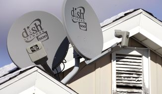 FILE - In this Nov. 10, 2008 file photo, Dish Network Corp. satellite dishes are attached to a home in Buffalo, N.Y.  Dish Network and Disney have reached a landmark deal Tuesday, March 4, 2014,  that envisions the day when Dish will offer a Netflix-like TV service to people who'd rather stream TV over the Internet than put a satellite receiver on their roof.  (AP Photo/David Duprey, file)