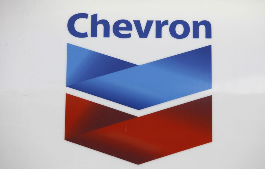FILE - In this July 25, 2011, file photo, a Chevron logo appears at a gas station in Miami. The American lawyer who advised Ecuadorean residents as they won a $9 billion judgment against Chevron Corp. says Tuesday, March 4, 2014 it's appalling that a New York judge found that the award resulted from fraud. (AP Photo/Lynne Sladky, File)