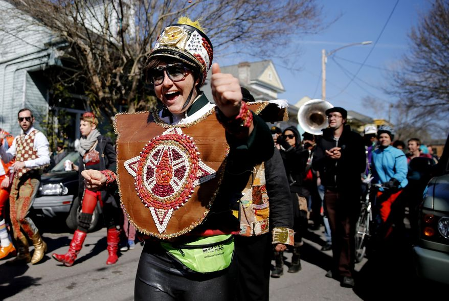 The sixth annual Red Beans Parade rolled through the Marigny and ended in the Treme with The Treme Brass Band on Lundi Gras, Monday, March 3, 2014, in New Orleans. Participants sported costumes made of various kinds of beans. (AP Photo/NOLA.com The Times-Picayune, Kathleen Flynn) MAGS OUT; NO SALES; USA TODAY OUT; THE BATON ROUGE ADVOCATE OUT