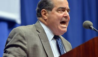 FILE - In this Oct. 2, 2013 file photo, Supreme Court Justice Antonin Scalia speaks at Tufts University in Medford, Mass. Aided by video captured by dashboard cameras in police cruisers, Supreme Court justices on Tuesday seemed poised to rule for police officers involved in a high-speed chase that ended with the deaths of the fleeing driver and his passenger. (AP Photo/Josh Reynolds, File)