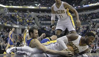 Indiana Pacers' Roy Hibbert (55) and Golden State Warriors' Andrew Bogut (12) battle for a loose ball as David West (21) watches during the first half of an NBA basketball game Tuesday, March 4, 2014, in Indianapolis. (AP Photo/Darron Cummings)