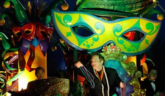 "The Krewe of Orpheus rolls in uptown New Orleans, led by celebrity monarch Quentin Tarantino reigning over the superkrewe's 32-float parade on Lundi Gras, Monday, March 3, 2014. The float theme for 2014 is ""Orpheus: The Enchanted World.""  Signature floats include the Trojan Horse, the Dolly Trolley and the Leviathan; flambeaux also will be featured. Throws include beads, cups and oversized doubloons. Parade ends at the Convention Center, where the Orpheuscapade commenced. (AP Photo/NOLA.com The Times-Picayune, David Grunfeld) MAGS OUT; NO SALES; USA TODAY OUT; THE BATON ROUGE ADVOCATE OUT"